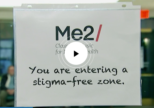 Me2 Orchestra Stigma-Free Zone sign with play button