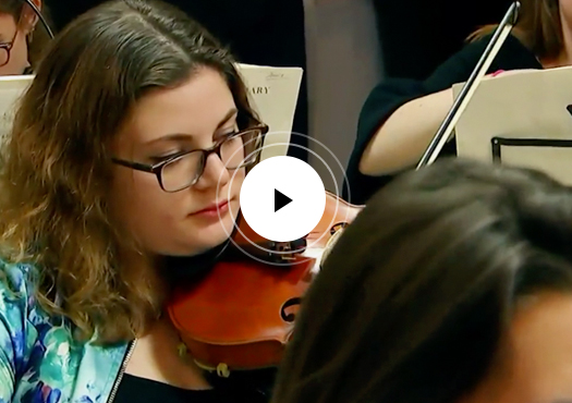Violist rehearsing with play button