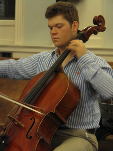 cellist playing with eyes closed