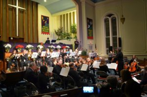 Me2 orchestra performing in a church