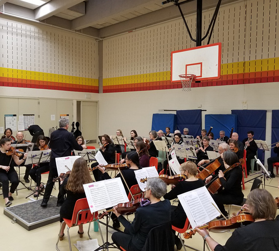 Me2 Orchestra performing in the Fuller Gym