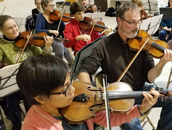 Burlington string section in rehearsal